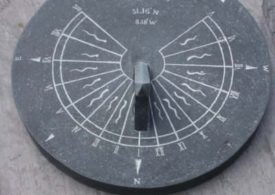Limestone sundial with compass points